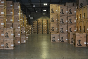 Boxes stacked in a warehouse leased by Howland Development in Wilmington, MA