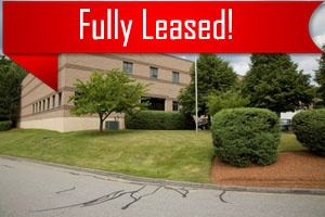 A piece of commercial real estate that is fully leased through Howland Development in Wilmington, MA